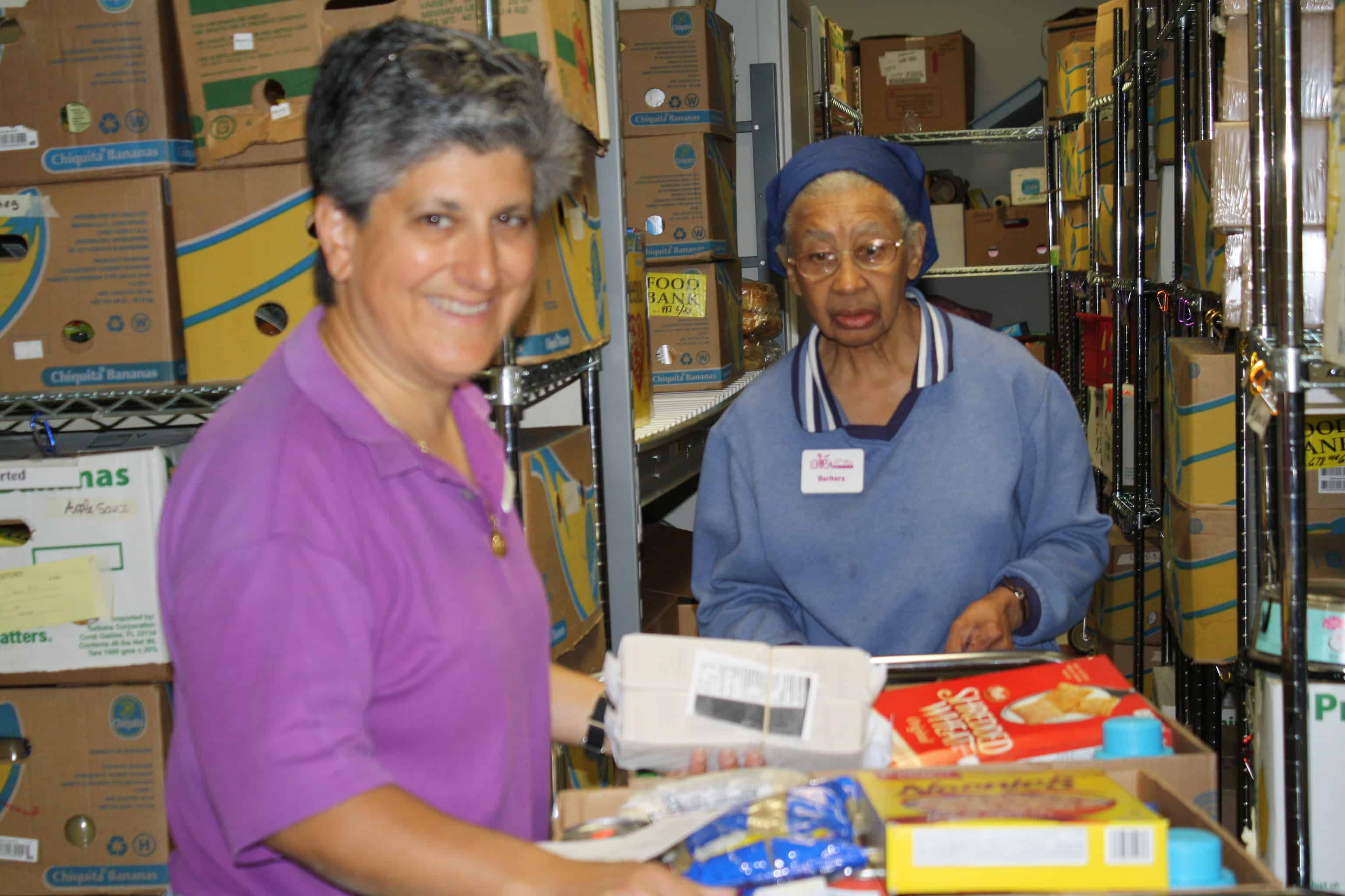 Volunteers Restocking Shelves