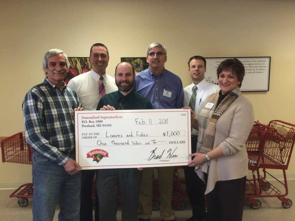 Mike Littrell, Former Ayer Store Manager and representatives from Hannaford corporate offices, Brian Fabre, Jeffrey Castonguay and Michael Norton presented a donation to Patricia Stern, Executive Director and Paul Niemira, Food Coordinator.